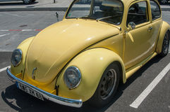 Old Volkswagen yellow beetle parked in the street Royalty Free Stock Photo