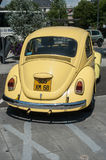 Old Volkswagen yellow beetle parked in the street Royalty Free Stock Photos