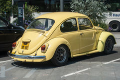 Old Volkswagen yellow beetle parked in the street Stock Photography
