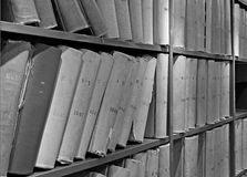 Old volume of library books on shelves Stock Photos