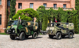 Old Volvo military off-road vehicles near the castle in Rzucewo. Old Swedish off-road military vehicles near neogothic castle serving as a hotel and restaurant Stock Image