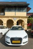 Old vs New - both showing wealth and prosperity. Goa, India - Dec 18, 2018: An Audi car parked outside an old Portuguese style house in Goa, India. India is stock images