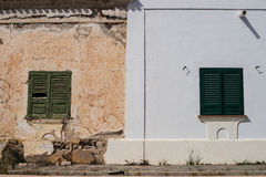 Old vs. new. Partly restored decaying facade, an old vs. new concept royalty free stock photos