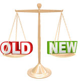 Old Vs New Words on Balance Scale Weighing Comparison Royalty Free Stock Photography