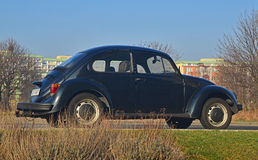 Old VW Beetle parked Stock Images