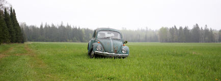 OLD VW BUG. Old VW Beetle at rest in the middle of an open field Royalty Free Stock Photos