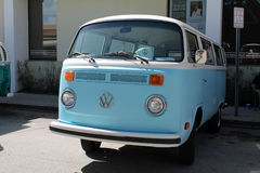 Old VW microbus parked. Old light blue Volkswagen Microbus parked next to sign outdoors on a sunny Miami day royalty free stock images