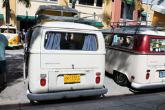 Old VW microbus parked. Rearfacing old light blue Volkswagen Microbus parked in reverse in a row next to other microbus outdoors on a sunny Miami day royalty free stock photo
