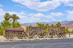 Old waggons in the Death valley. Old waggon at the entrance of the Furnance Creek Ranch in the middle of Death Valley, with these wagons the first men crossed Stock Photo