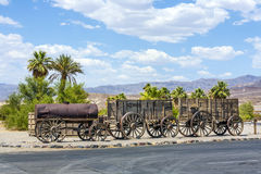 Old waggons in the Death valley. Old waggon at the entrance of the Furnance Creek Ranch in the middle of Death Valley, with these wagons the first men crossed Stock Photography