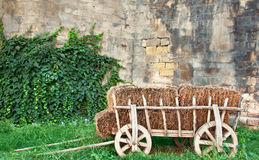 Old wagon. Next to tower wall stock photos