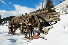 Old Wagon. An old wagon in a snowy setting.  A fishing pole is mounted on the side Stock Images