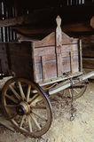 Old Wagon in Barn. An old wagon parked inside of a barn Royalty Free Stock Photo