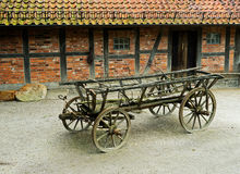 The old wagon in barnyard next at barn Royalty Free Stock Image