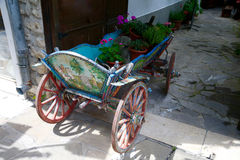Old wagon with flowers. Nesebar Bulgaria. Old wagon with flowers. Nesebar. Bulgaria Stock Images