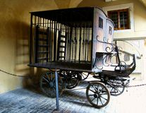 Old wagon in Kriminalmuseum. An old wagon for prisoner's transportation under the porch of Kriminalmuseum in Rothenburg (Germany Stock Images