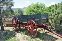 Old Wagon. An old wagon with red wheels Royalty Free Stock Photography