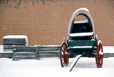 Old Wagon Sits Idle in a Heavy Winter Snow Royalty Free Stock Image
