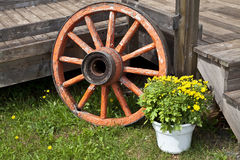 Old Wagon Wheel. An old wagon wheel used as an outside decoration for a home deck royalty free stock photos