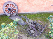 Old wagon wheel and farm implement Stock Images