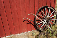 Old Wagon Wheel Red Wall Royalty Free Stock Image