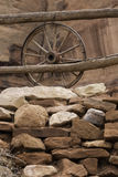 Old wagon wheel. An old wagon wheel on a old wooden fence Royalty Free Stock Photography