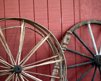 Old wagon wheels. These old wagon wheels were for sale in front of an antique shop Stock Photos