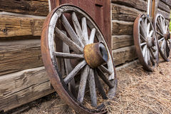 Old wagon wheels against a wall. Stock Image