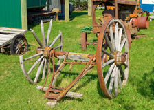 Old wagon wheels on display at an outdoor museum in northern canada Stock Images