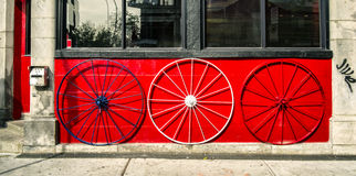 Old Wagon Wheels. In front of a bar stock photography