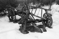 Old wagon. Old wooden wagon in some snow royalty free stock photography