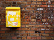 Old wail box. Old yellow mail box on the brick wall Royalty Free Stock Photos