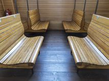 Old waiting room near office in the railway station in last millenium. With tables seating bench Royalty Free Stock Photo