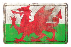 Old Wales flag. 3d rendering of a Wales flag over a rusty metallic plate. Isolated on white background Stock Photos