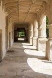 Old walkway. Old pillar lined walkway adjacent to formal gardens in stock photo