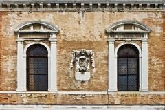 Old wall. With windows and skull in center Royalty Free Stock Images