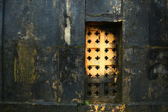 Old  wall. An old wet wall with a closed door on it Royalty Free Stock Photo