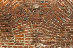 Old wall. Old red brick wall with archs base stock photos
