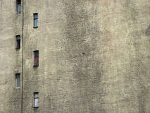 Old wall. Narrow windows on the blank wall of old house Royalty Free Stock Image