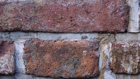 Old wall with ancient brickwork, brick background. Old wall with ancient crumbling brickwork, you can see the structure of the bricks, close-up. The camera stock footage