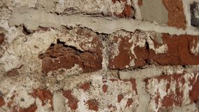 Old wall with ancient brickwork, brick background. Old wall with ancient crumbling brickwork, you can see the structure of the bricks. The camera moves from stock footage