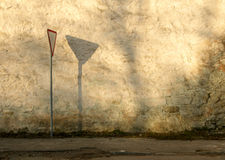 Old Wall And Road Sign Stock Image