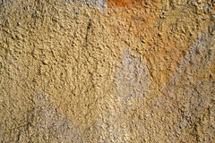 Old Wall Background. Old yellow painted plaster grunge wall background Royalty Free Stock Image
