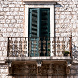 Old wall with balcony and window Royalty Free Stock Images