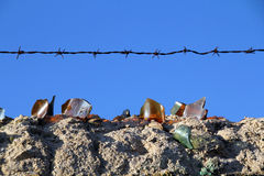 Old wall with barbed wire and crystals Stock Photo