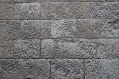 Old wall of beige and grey blocks of Jerusalem stone texture Royalty Free Stock Images