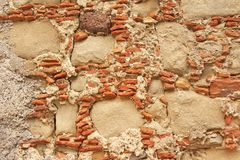 Old Wall of Big and Small Stones. Terracotta and Beige Stones. T royalty free stock image