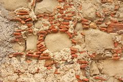 Old Wall of Big and Small Stones. Terracotta and Beige Stones. Terracotta Background. Background of the Old Terracotta Stones. For stock images