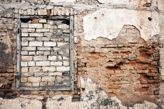 Old wall with boarded up window Royalty Free Stock Photo