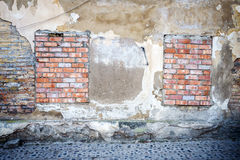 Old wall with bricked up windows Stock Images